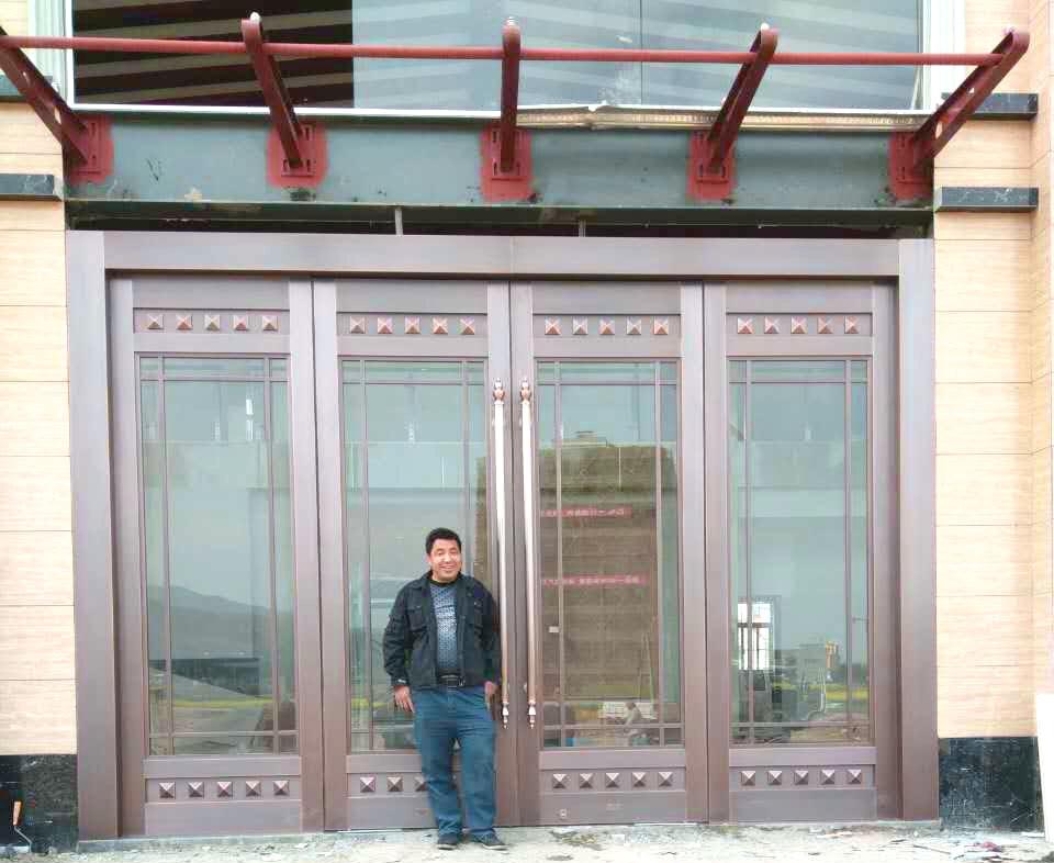 安康阳光水岸售楼中心铜地弹门案例