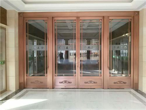玻璃四开地弹铜门