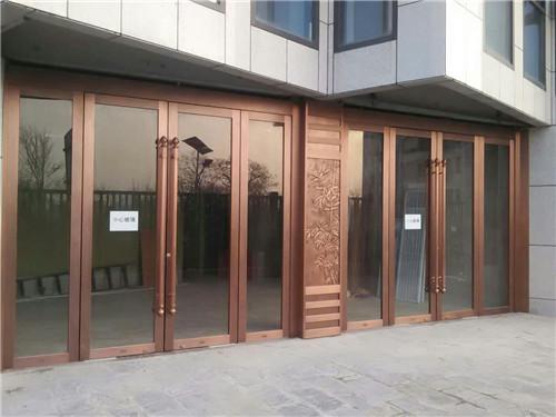 木纹玻璃铜门